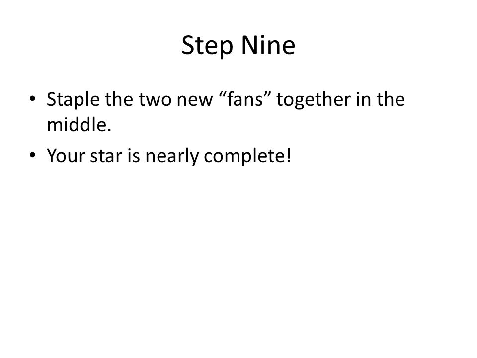 "Step Nine Staple the two new ""fans"" together in the middle. Your star is nearly complete!"