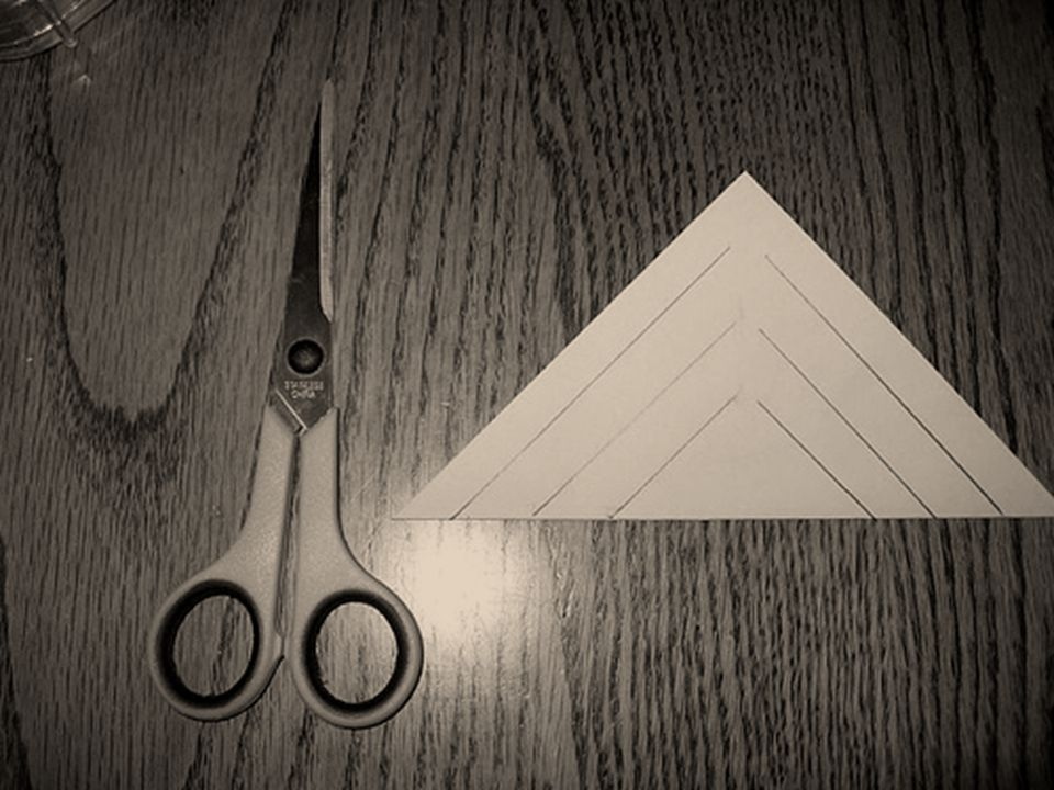 Step three Unfold your paper and turn it so that the diamond shape is facing you.
