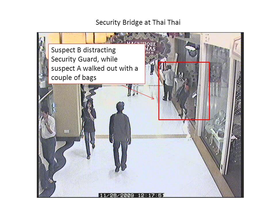 Security Bridge at Thai Thai Suspect B distracting Security Guard during the getaway.