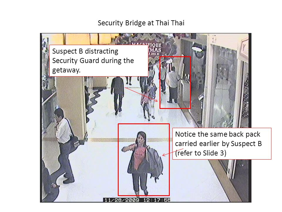 Security Bridge at Thai Thai Suspect B distracting Security Guard during the getaway. Notice the same back pack carried earlier by Suspect B (refer to