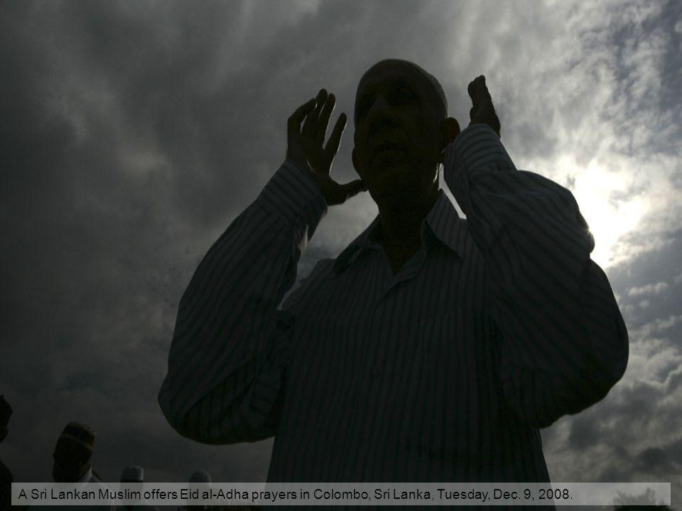 A Sri Lankan Muslim offers Eid al-Adha prayers in Colombo, Sri Lanka, Tuesday, Dec. 9, 2008.