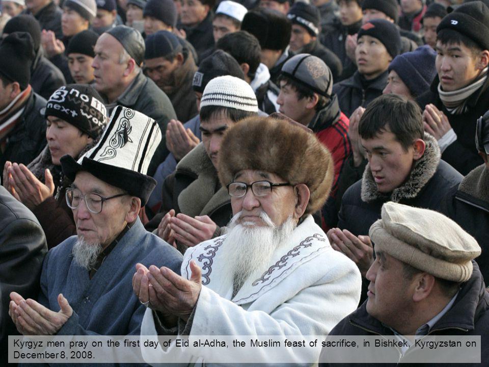 Kyrgyz men pray on the first day of Eid al-Adha, the Muslim feast of sacrifice, in Bishkek, Kyrgyzstan on December 8, 2008.
