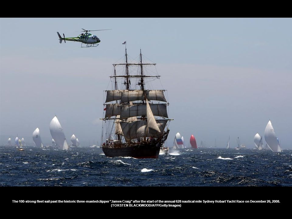 The 100-strong fleet sail past the historic three-masted clipper James Craig after the start of the annual 628 nautical mile Sydney Hobart Yacht Race on December 26, 2008.