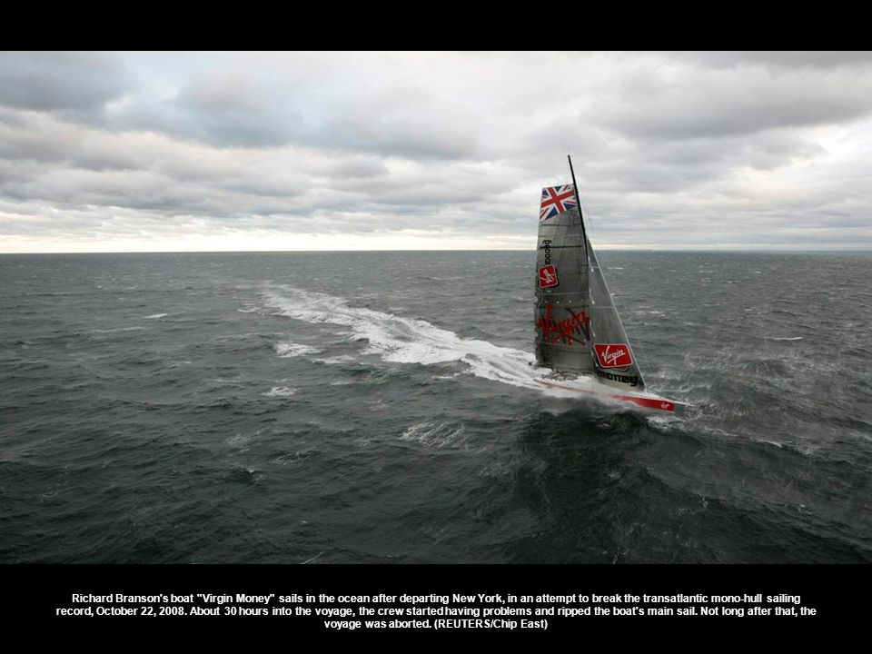 Limit sails past Tasman Island towards the finish line in Hobart during the Sydney to Hobart yacht race in Australia Sunday, Dec.
