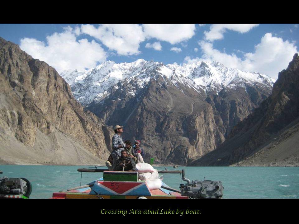 Crossing Ata-abad Lake by boat.
