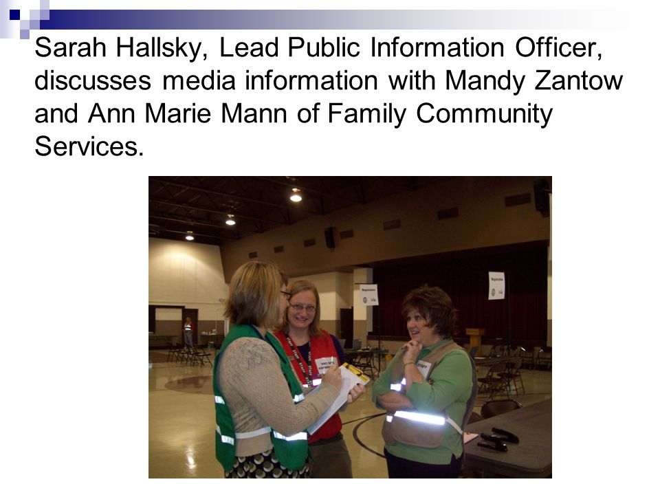 Sarah Hallsky, Lead Public Information Officer, discusses media information with Mandy Zantow and Ann Marie Mann of Family Community Services.