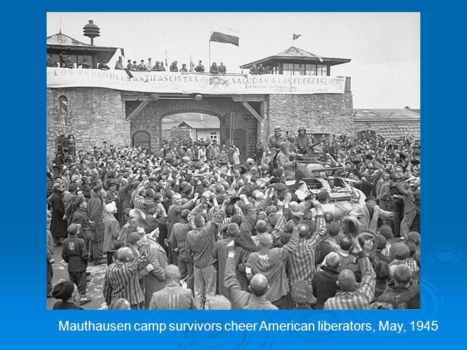 Mauthausen camp survivors cheer American liberators, May, 1945
