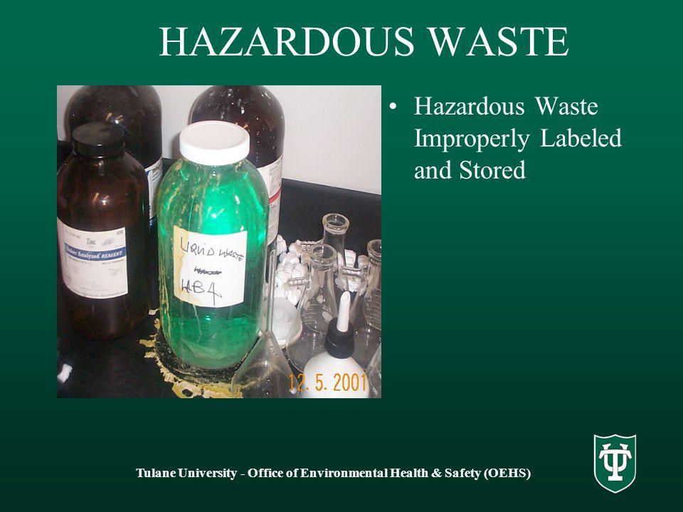 HAZARDOUS WASTE Hazardous Waste Improperly Labeled and Stored Tulane University - Office of Environmental Health & Safety (OEHS)