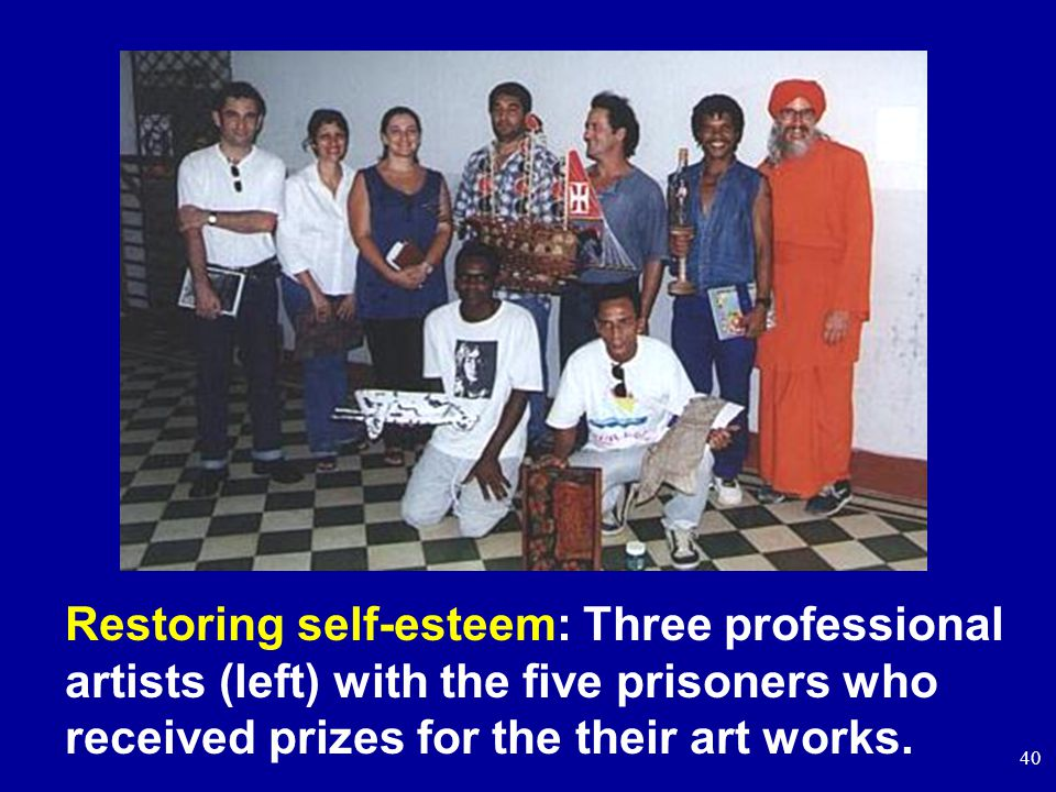 40 Restoring self-esteem: Three professional artists (left) with the five prisoners who received prizes for the their art works.