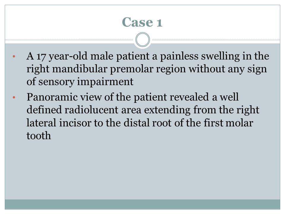 Case 1 A 17 year-old male patient a painless swelling in the right mandibular premolar region without any sign of sensory impairment Panoramic view of