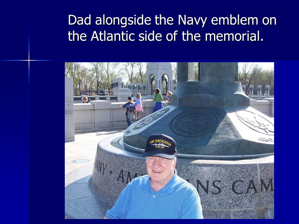 Dad alongside the Navy emblem on the Atlantic side of the memorial.