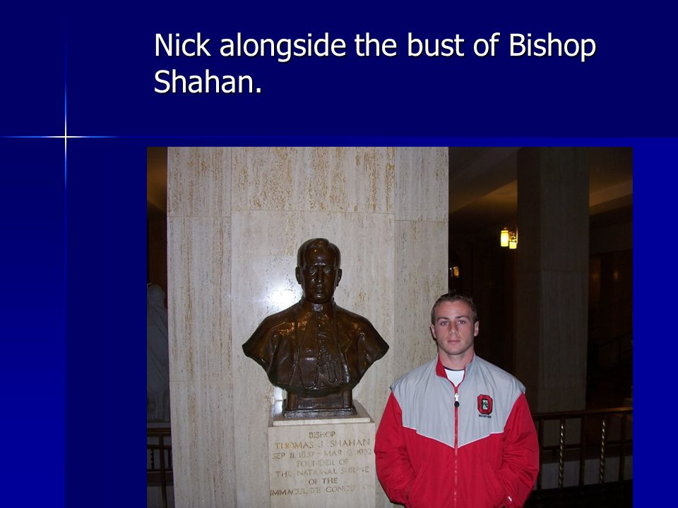 Nick alongside the bust of Bishop Shahan.