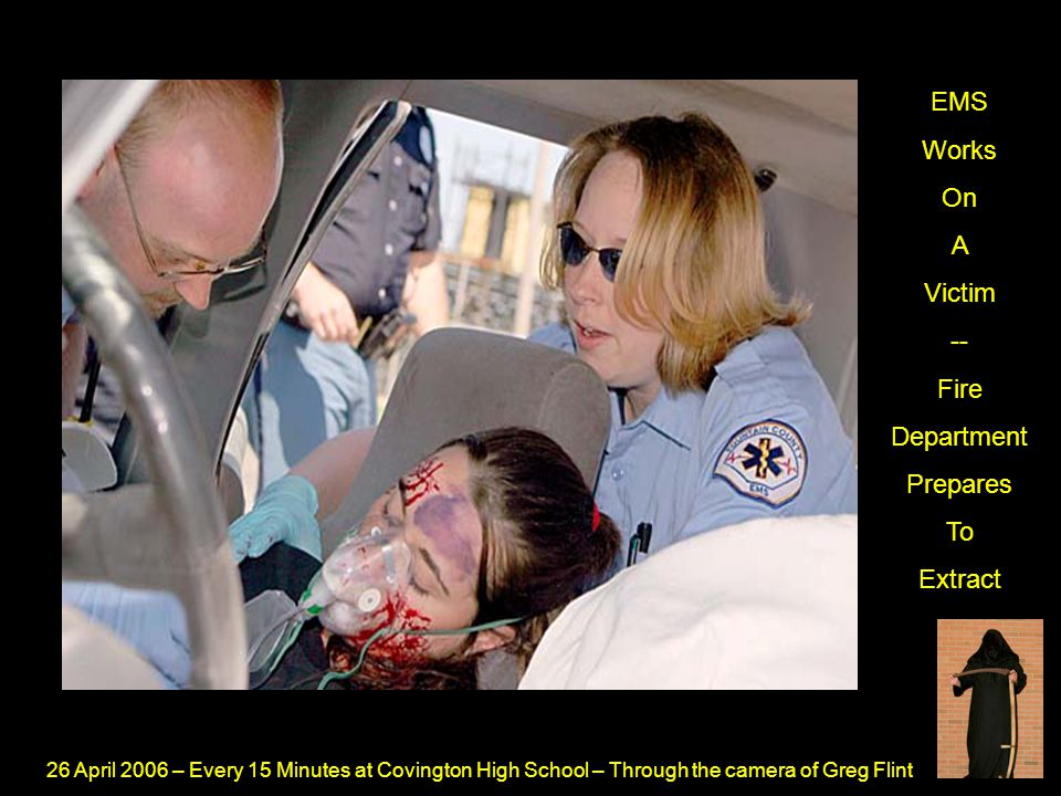 26 April 2006 – Every 15 Minutes at Covington High School – Through the camera of Greg Flint EMS Works On A Victim -- Fire Department Prepares To Extr
