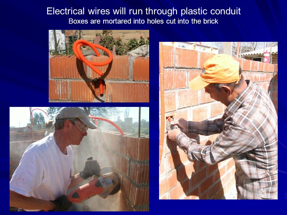 Electrical wires will run through plastic conduit Boxes are mortared into holes cut into the brick