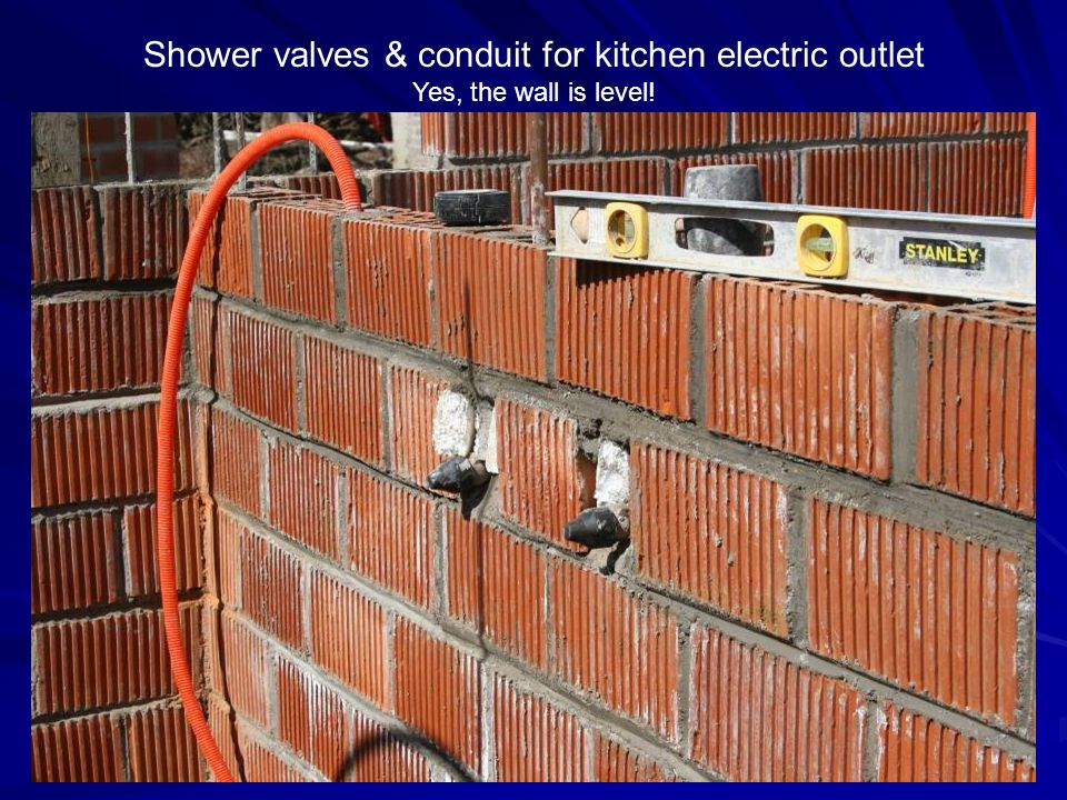 Shower valves & conduit for kitchen electric outlet Yes, the wall is level!