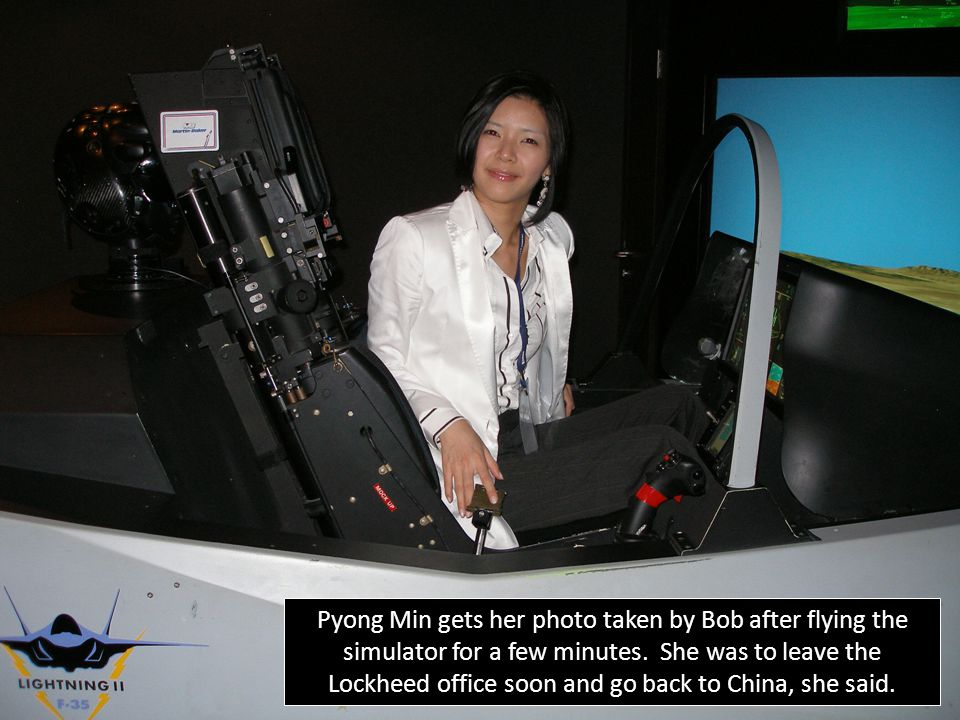 Pyong Min gets her photo taken by Bob after flying the simulator for a few minutes.