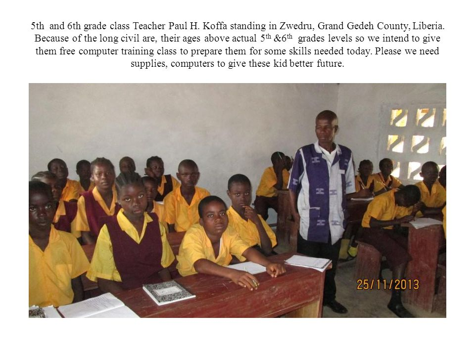 5th and 6th grade class Teacher Paul H. Koffa standing in Zwedru, Grand Gedeh County, Liberia.