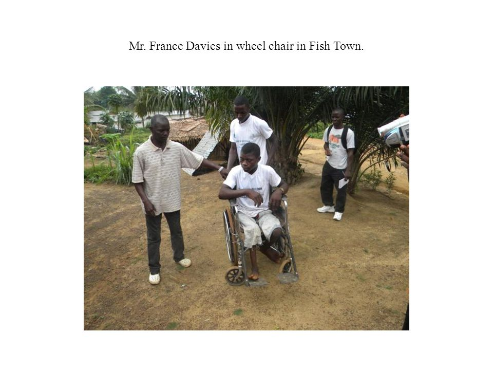 Mr. France Davies in wheel chair in Fish Town.