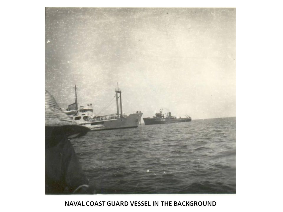NAVAL COAST GUARD VESSEL IN THE BACKGROUND