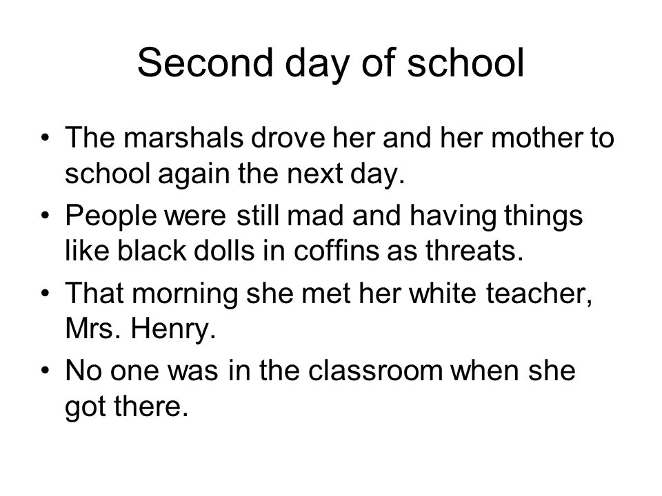Second day of school The marshals drove her and her mother to school again the next day. People were still mad and having things like black dolls in c