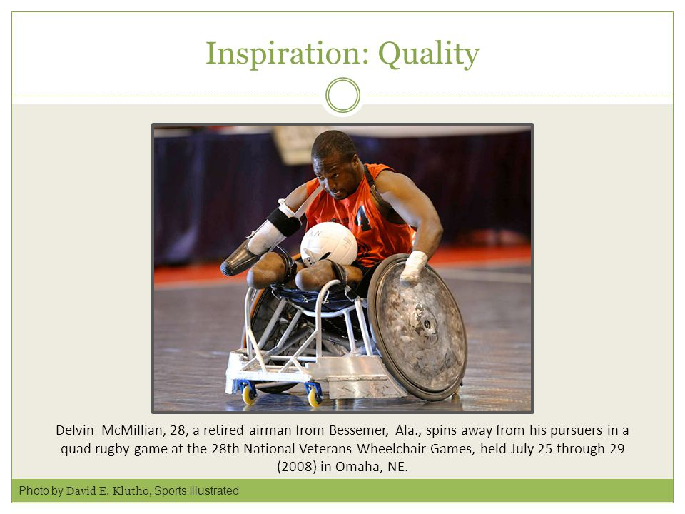 Inspiration: Quality Delvin McMillian, 28, a retired airman from Bessemer, Ala., spins away from his pursuers in a quad rugby game at the 28th National Veterans Wheelchair Games, held July 25 through 29 (2008) in Omaha, NE.
