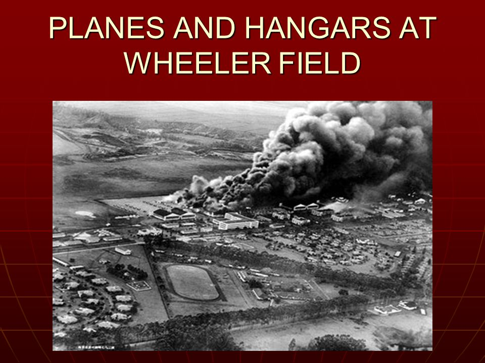 PLANES AND HANGARS AT WHEELER FIELD