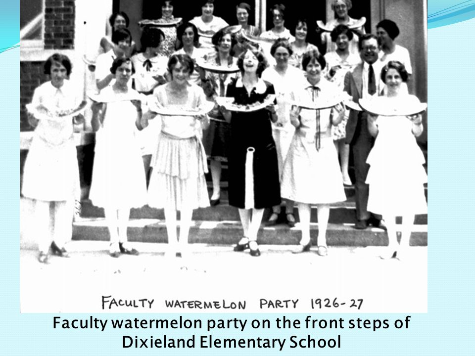 Faculty watermelon party on the front steps of Dixieland Elementary School