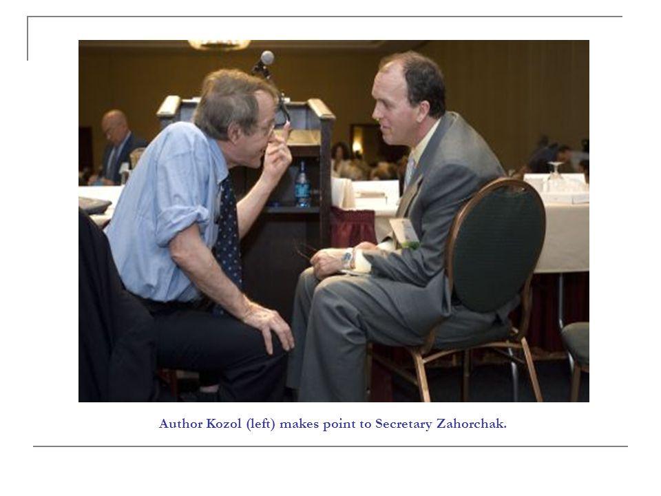 Author Kozol (left) makes point to Secretary Zahorchak.