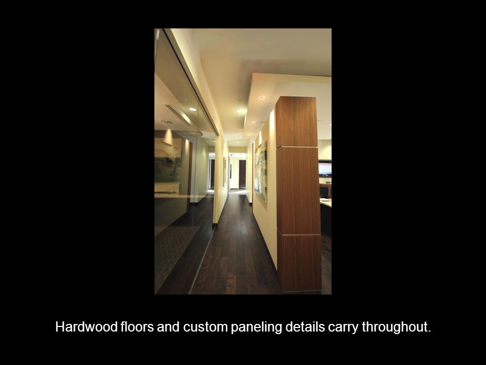 The conference room features custom woodwork and lighting.