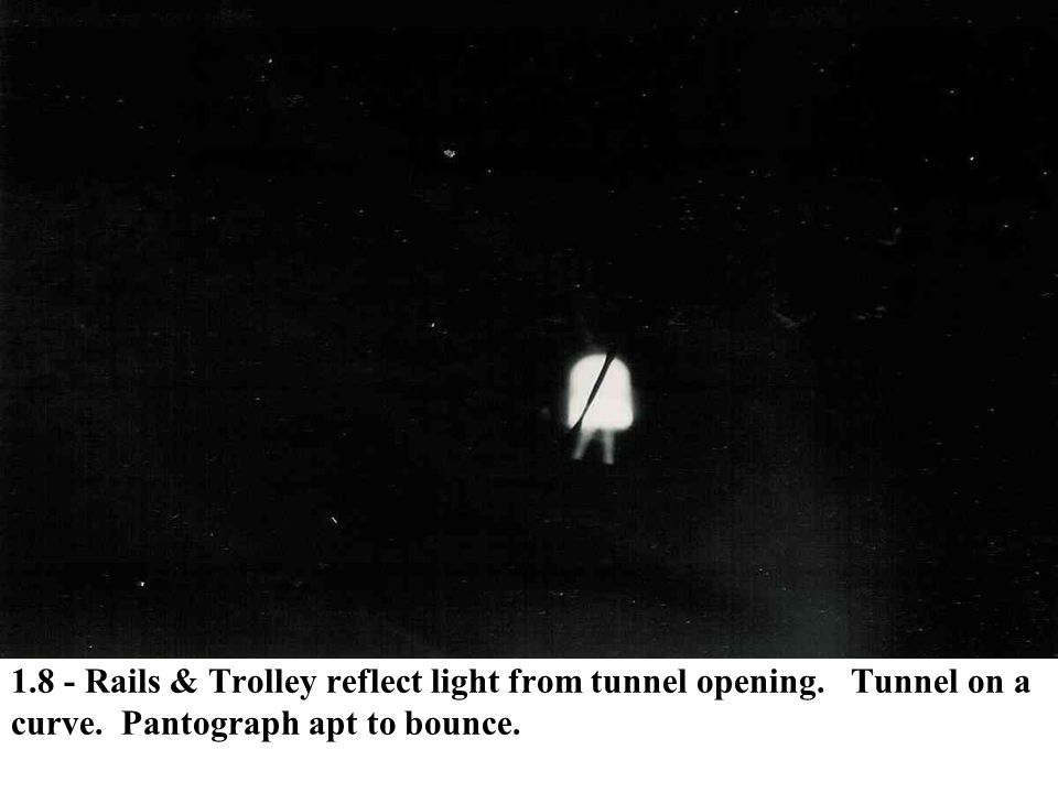 1.8 - Rails & Trolley reflect light from tunnel opening. Tunnel on a curve. Pantograph apt to bounce.