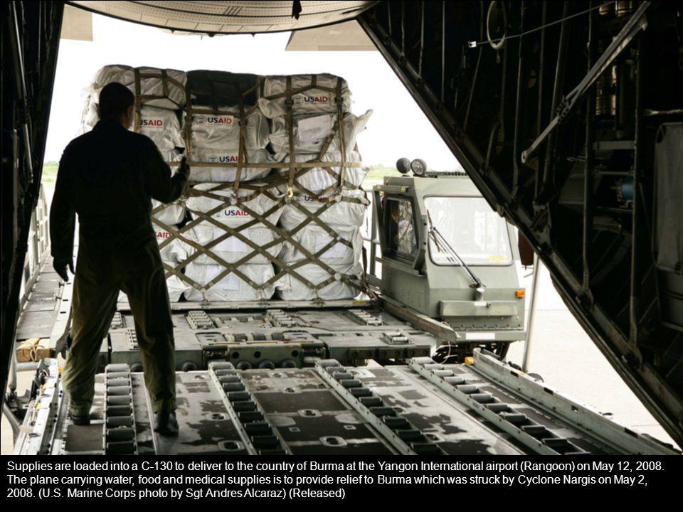 Supplies are loaded into a C-130 to deliver to the country of Burma at the Yangon International airport (Rangoon) on May 12, 2008. The plane carrying