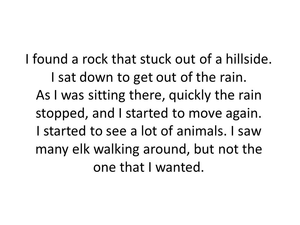 I found a rock that stuck out of a hillside. I sat down to get out of the rain.