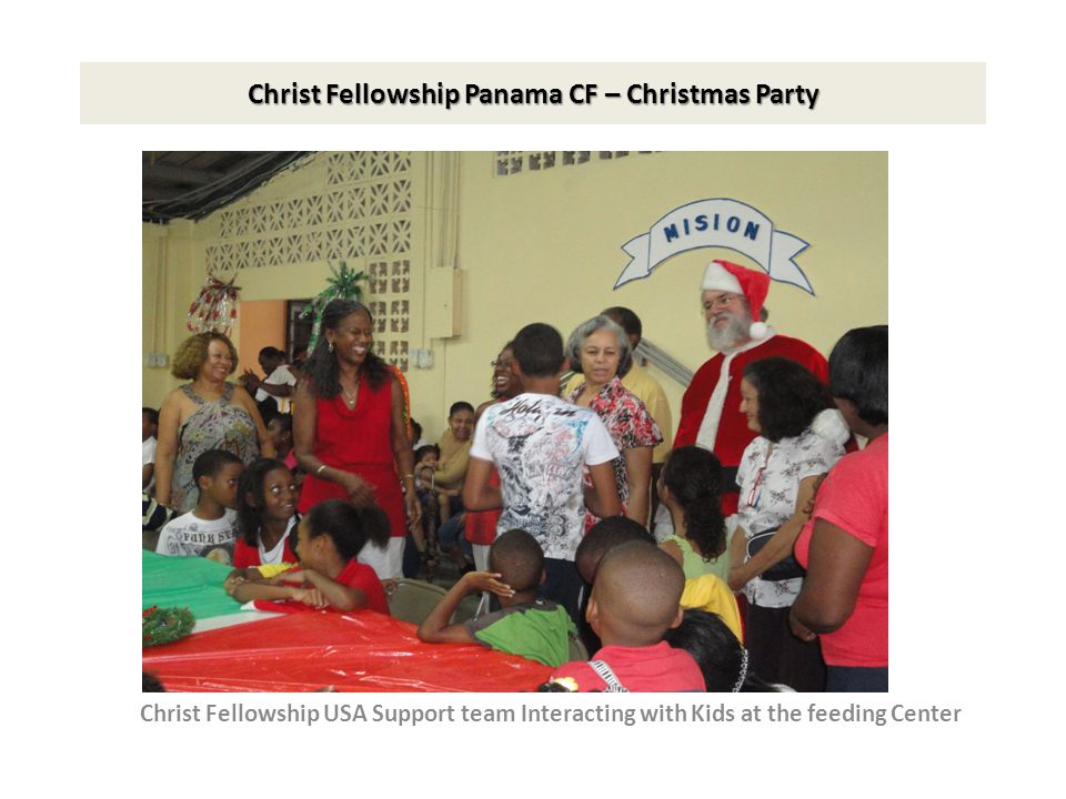 Christ Fellowship Panama CF – Christmas Party Support Team interacting with kids at the feeding center