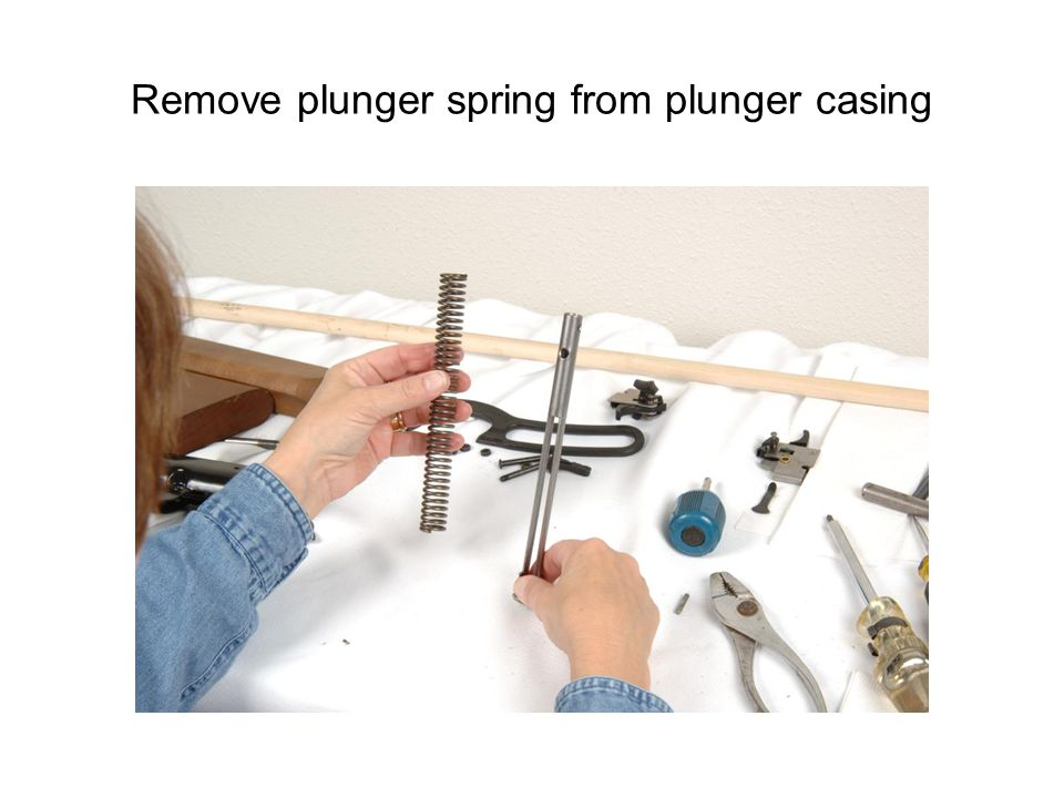 Remove plunger spring from plunger casing