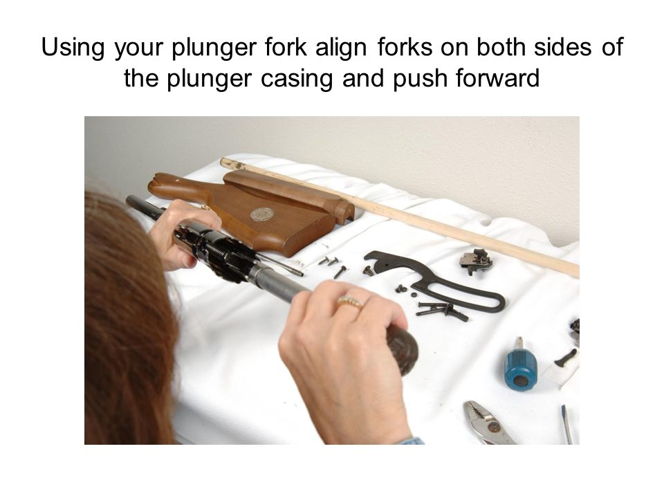Using your plunger fork align forks on both sides of the plunger casing and push forward