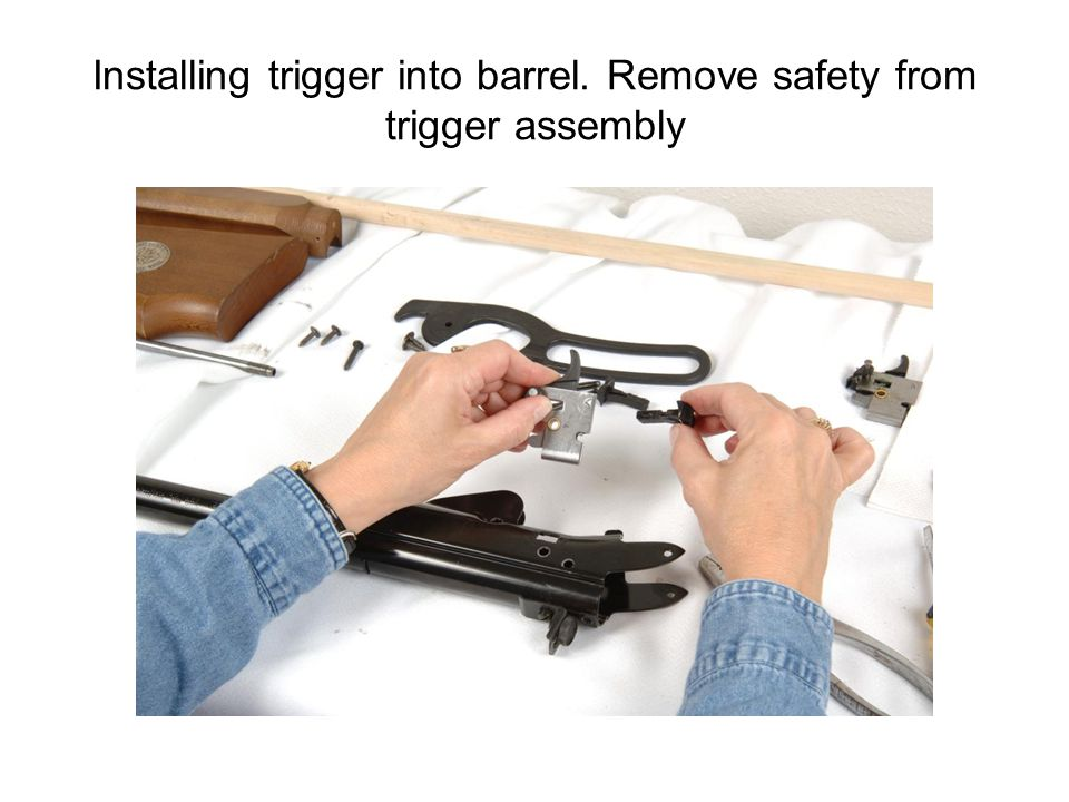 Installing trigger into barrel. Remove safety from trigger assembly