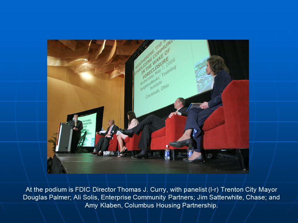 At the podium is FDIC Director Thomas J.