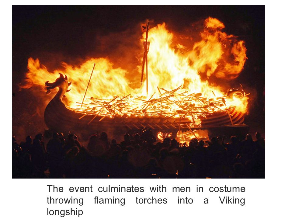 The event culminates with men in costume throwing flaming torches into a Viking longship