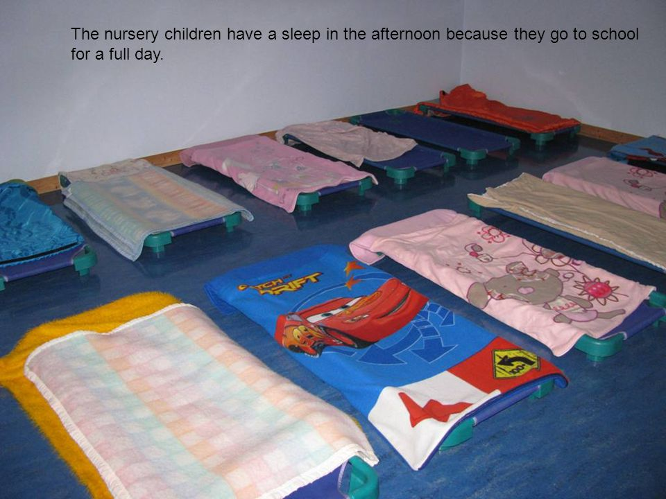 The nursery children have a sleep in the afternoon because they go to school for a full day.