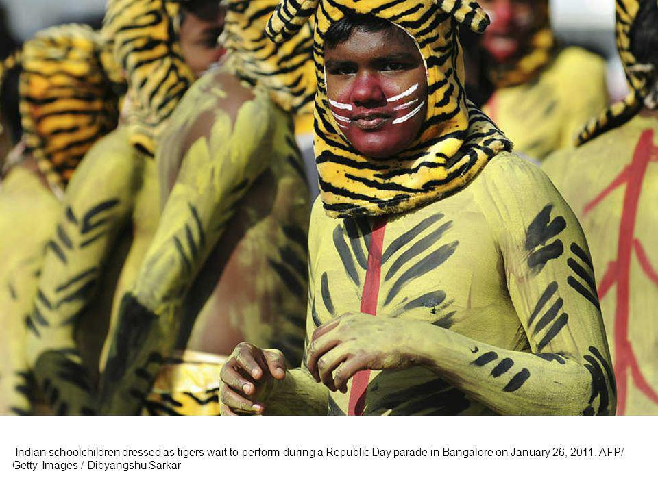 Indian schoolchildren participate in a cultural dance program during a Republic Day parade in Bangalore on January 26, 2011.