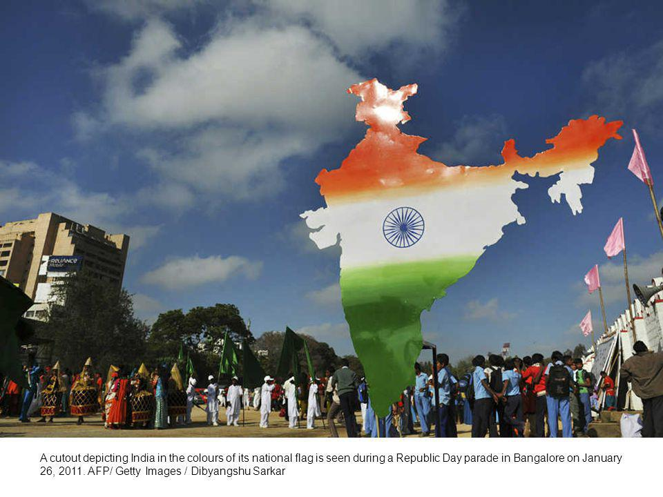 Indian schoolchildren dressed as tigers wait to perform during a Republic Day parade in Bangalore on January 26, 2011.