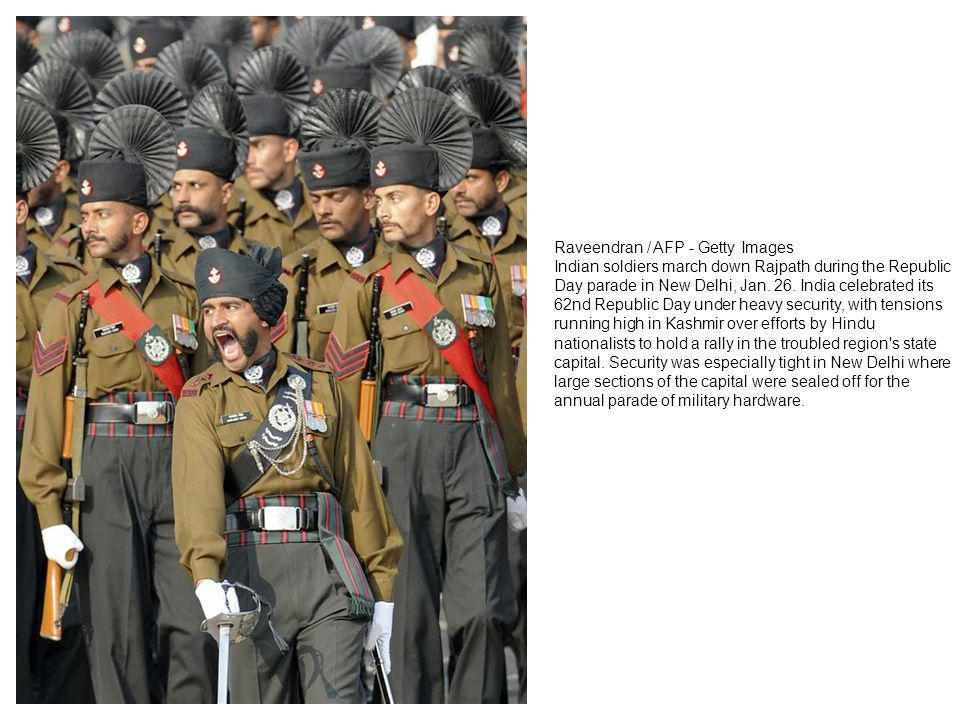 Indian soldiers march down Rajpath during the Republic Day parade in New Delhi on January 26, 2011.