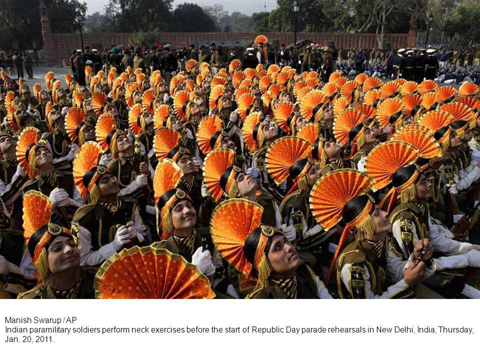 Mahesh Kumar A / AP Indian band members are reflected on a musical instrument during a rehearsal for the Republic Day in Hyderabad, India, Jan.