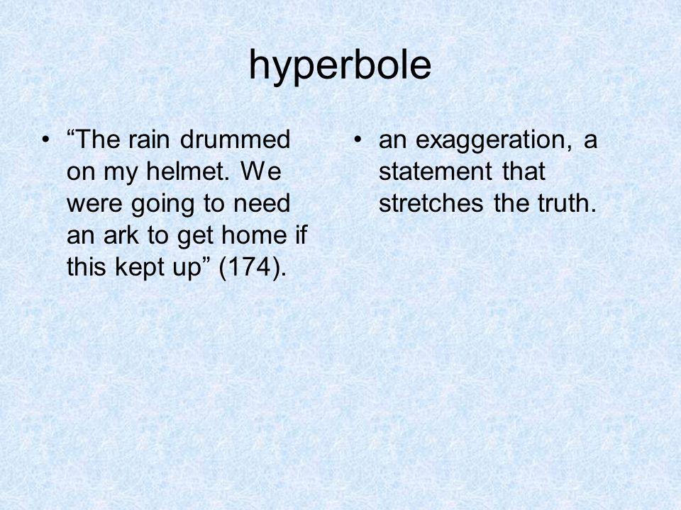 hyperbole The rain drummed on my helmet.