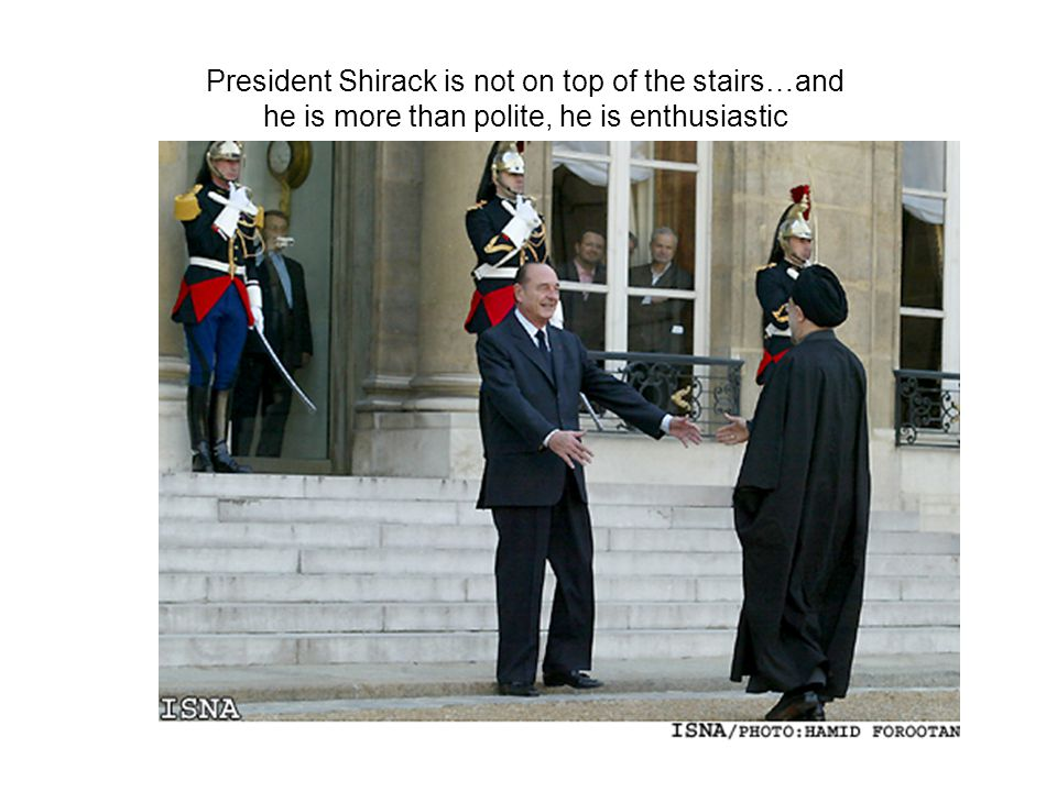President Shirack is not on top of the stairs…and he is more than polite, he is enthusiastic