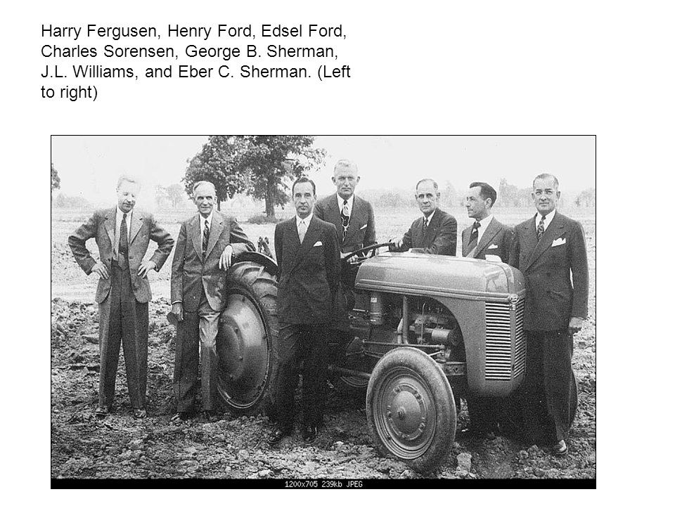 Harry Fergusen, Henry Ford, Edsel Ford, Charles Sorensen, George B. Sherman, J.L. Williams, and Eber C. Sherman. (Left to right)