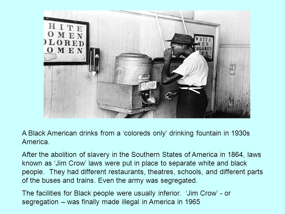 A Black American drinks from a 'coloreds only' drinking fountain in 1930s America.
