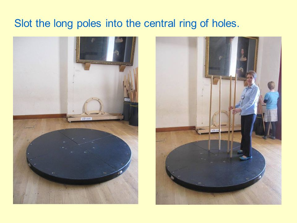 Fit the wooden ring onto the circle of long poles. You will need a few people for this.