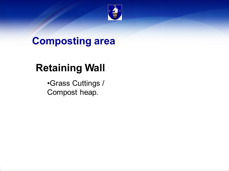 Composting area Retaining Wall Grass Cuttings / Compost heap.