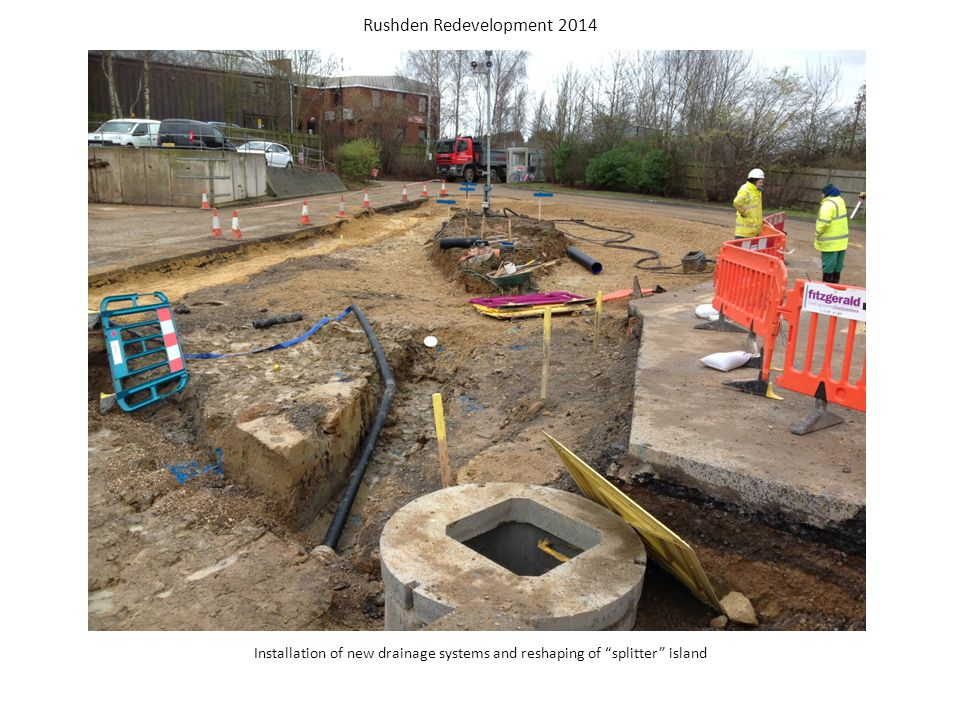Digging out the bank in preparation for installing a pre-cast concrete wall adjacent to the new small item recycling area Rushden Redevelopment 2014